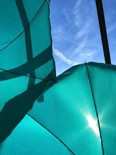 Blue Sky Gazebo Parasol Sun Summer Shade Sky Blue Low Angle View Day Nature No People Sunlight Built Structure Outdoors Protection Close-up Shadow Pattern Umbrella Cloud - Sky Turquoise Colored