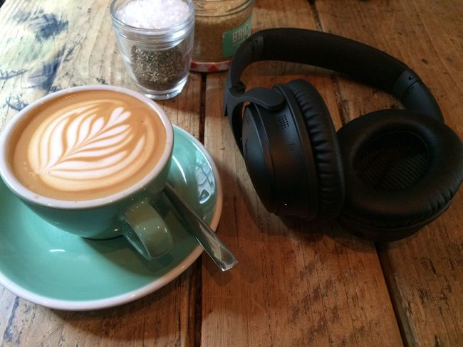 Essentials: coffee and noise-canceling headphones. Food And Drink Coffee Coffee - Drink Wood Cafe London Coworking Headphones Bose QC35 Table Nomadiclife Freelance Life