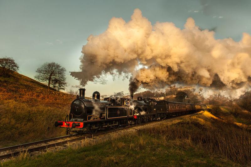 Steam engine train on landscape