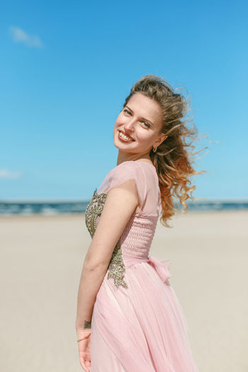 Portrait of a smiling young woman on beach