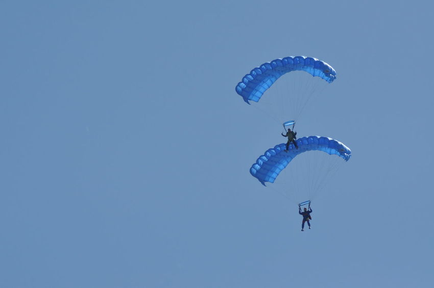 Parachutists from the Romanian Aeroclub Team and the Romanian Air Force Army jumping on the Romanian Air Fest on May 18, 2013 in Cluj Napoca, Romania Air Force Air Festival Brave Parachute Jump Parachutes Adventure Day Exhilaration Extreme Sports Flying Leisure Activity Lifestyles Men Mid-air Outdoors Parachute Parachute Sailing Parachuting Paragliding Real People RISK Romanian Air Forces Sky Skydiving Sport