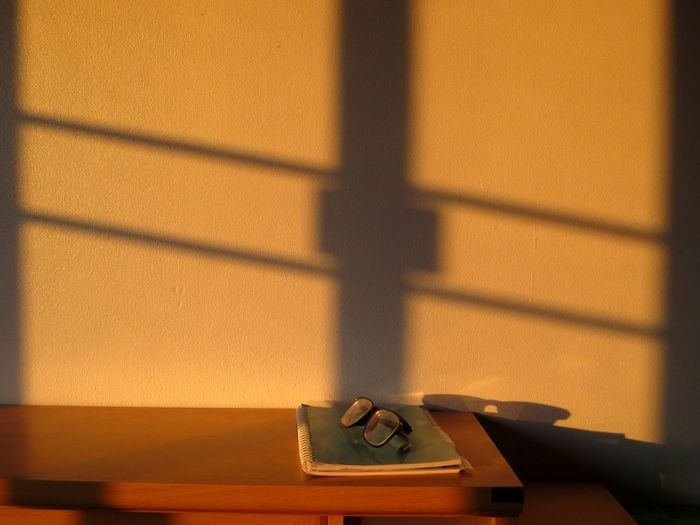 High angle view of book and eyeglasses on table