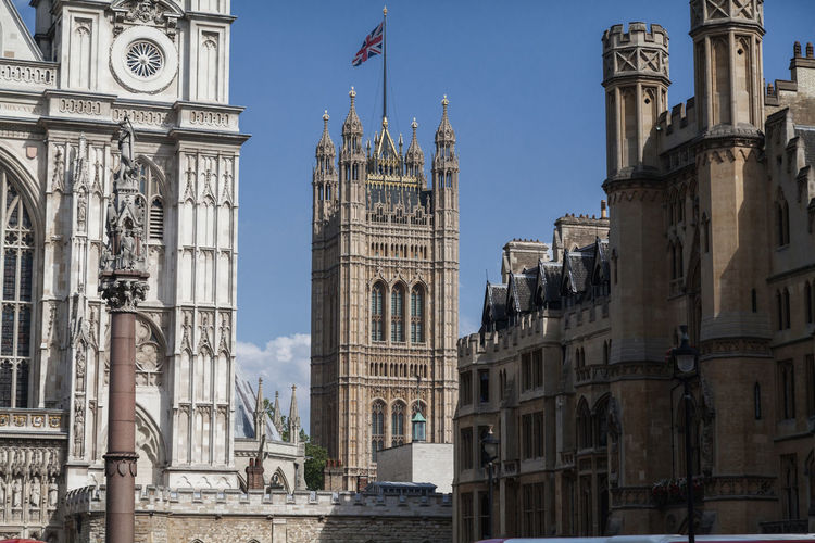 EyeEm Selects Travel Destinations Gothic Style Architecture Day No People Government Outdoors Clock Tower Sky Politics And Government King - Royal Person Tourism Sunny Historic Architecture Building Exterior London England Landmark Big Ben Parliament Building Built Structure Europe City Life
