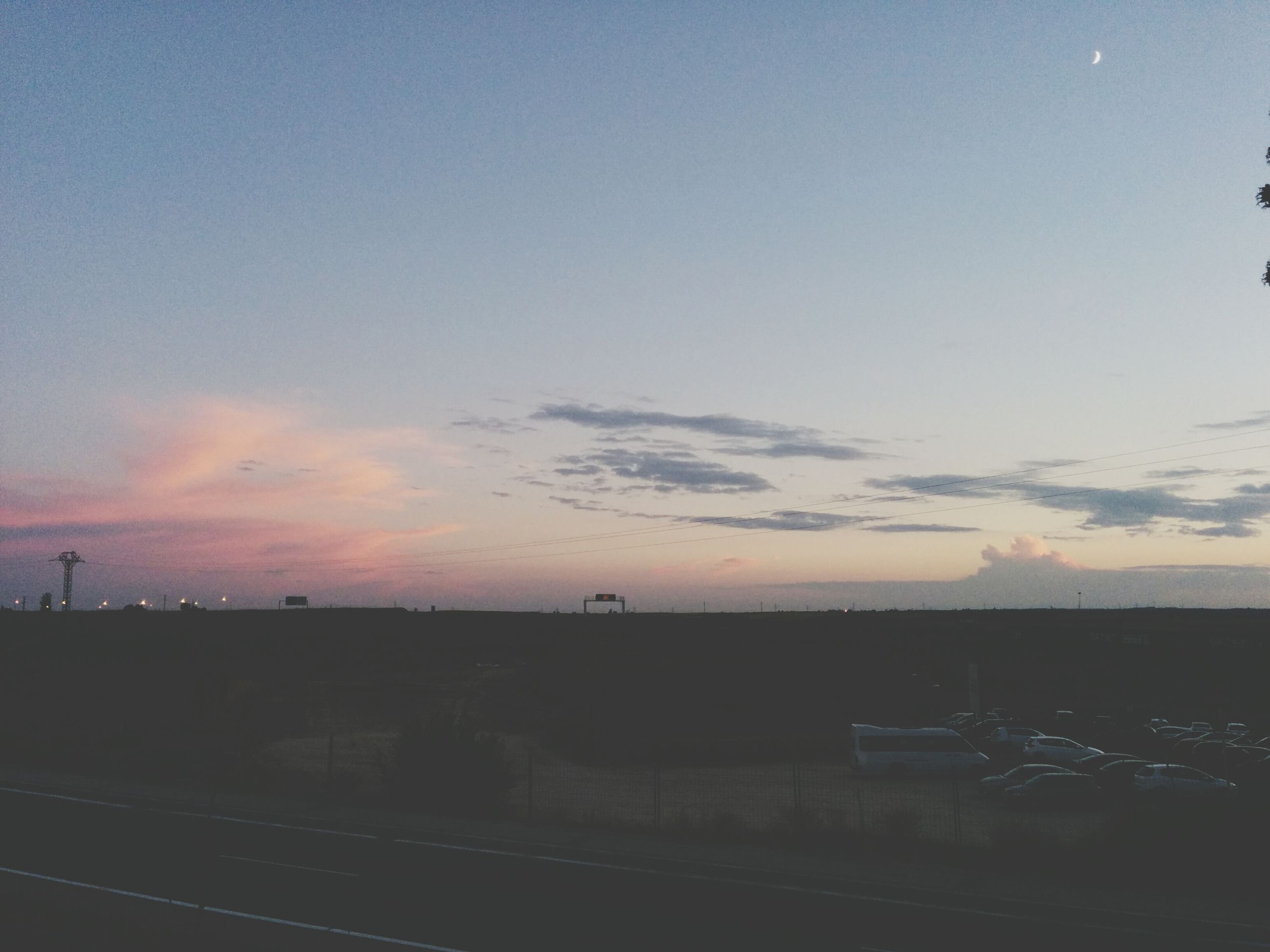 sunset, sky, landscape, silhouette, dusk, copy space, scenics, tranquil scene, built structure, nature, tranquility, building exterior, cloud - sky, beauty in nature, architecture, transportation, road, outdoors, no people, field