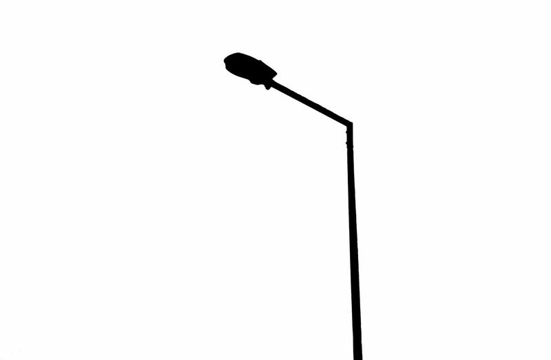 Low angle view of lighting equipment against white background