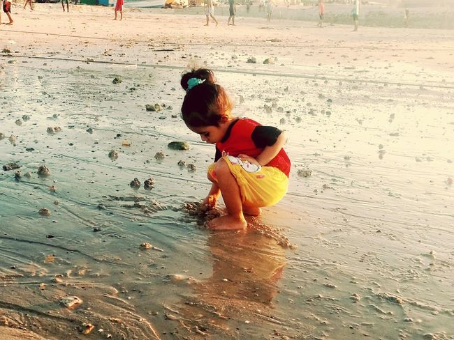 Family With One Child Beach Togetherness Child Water Nature Sand Pail And Shovel Sea Nature Beauty In Nature One Girl Only Outdoors
