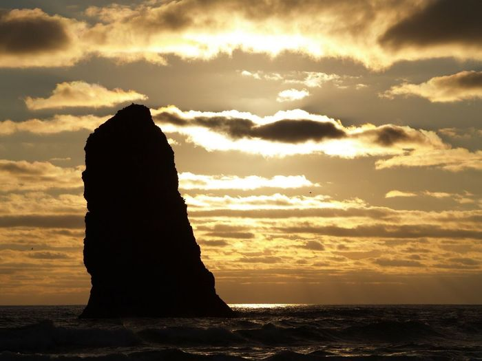 Scenic View Of Rock Formation At Sunset
