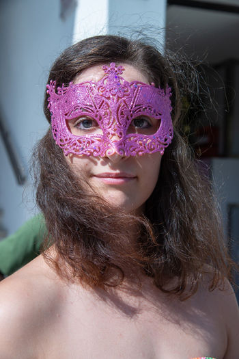 Portrait of young woman wearing eye mask