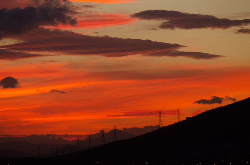 Panagor 85-205 mm f/ 3.8 Tele Zoom Auto Lens. Pure photograph without any post processing done Sunset #sun #clouds #skylovers #sky #nature #beautifulinnature #naturalbeauty #photography #landscape Vintage Lens Panagor 85-205 Red Color Orange Color Cloud - Sky Dark Dark Sunset Orange Sky Wonderful Evening Orange Sky Sunset Scenics - Nature Beauty In Nature Sky Tranquil Scene Mountain Tranquility Silhouette Environment Idyllic Landscape No People Nature Dramatic Sky Non-urban Scene Outdoors Romantic Sky