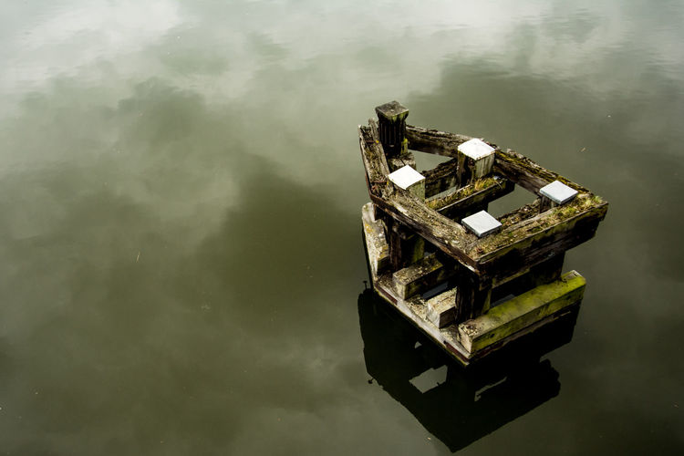 High angle view of abandoned ship against sky