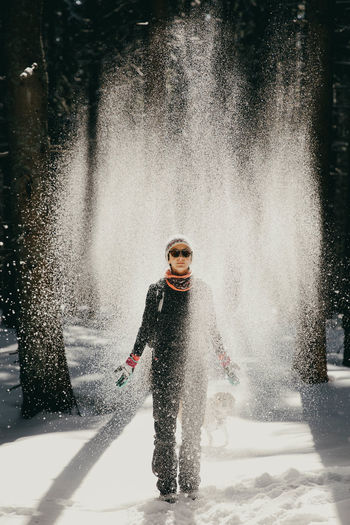 The girl and the snowing Winter Wintertime Winter Wonderland Winter Sport Mountain Mountains Happiness Happy People Happy Times Motion Day Lifestyles Young Adult Enjoyment Splashing Warm Clothing Outdoors Fun Nature Light Sunset Sunglasses Sunglass  Beautiful Woman Tree My Best Photo