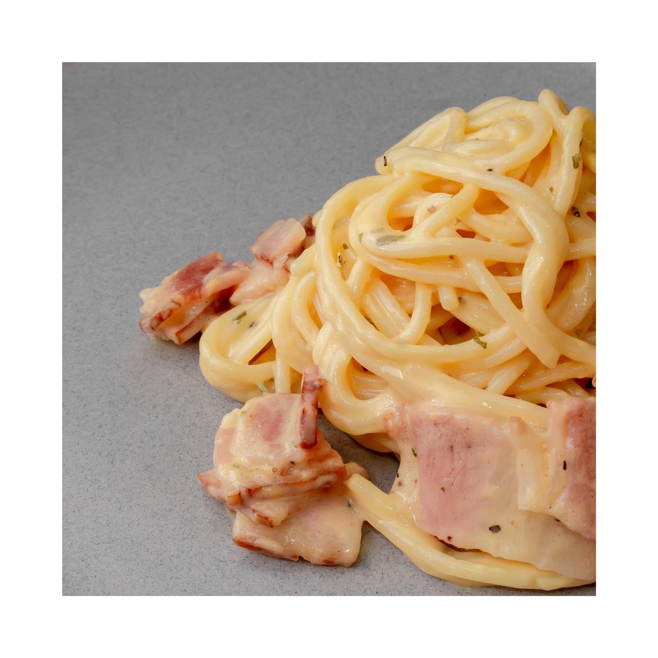 HIGH ANGLE VIEW OF PASTA WITH MEAT AND FORK
