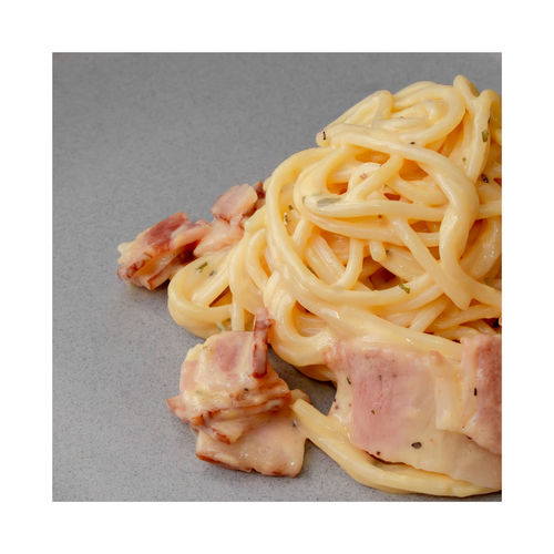 High angle view of noodles and meat on plate