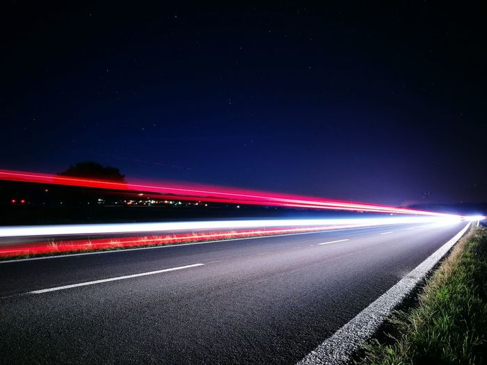 Motion Long Exposure Light Trail Speed Blurred Motion Night Road Illuminated Transportation On The Move Red The Way Forward Tail Light Vanishing Point Outdoors Sky Diminishing Perspective Lines Absrtact