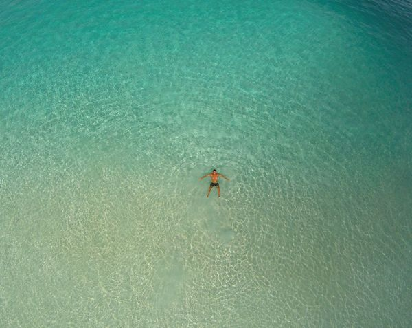 Adventure Beach Beauty In Nature Blue Drone  Fun Leisure Activity Lifestyles Nature Outdoors Seychelles Unrecognizable Person Vacations Water