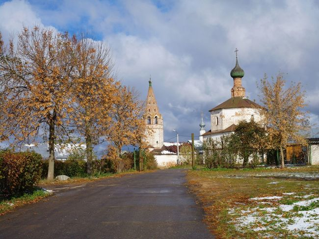 The road to old church Autumn Sky And Clouds Ancient Architecture Architecture Building Exterior Built Structure Cloud - Sky Day Leaves Nature No People Outdoors Place Of Worship Religion Road Sky Snow The Way Forward Tree Wet Day
