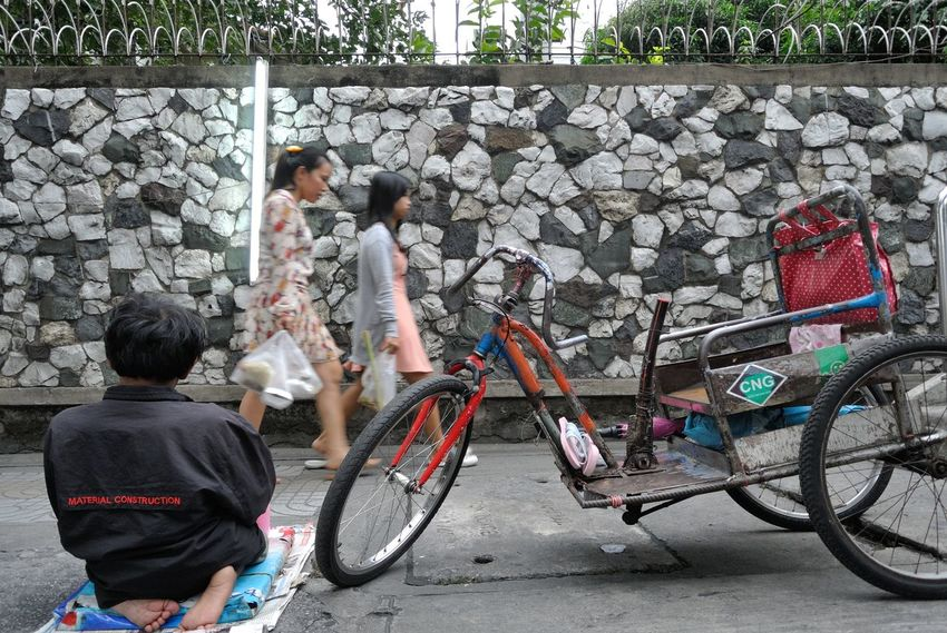 Beggar Bicycle Cultures Cycling Day Disabled Disabled Person Friendship Fun Land Vehicle Mode Of Transport Occupation Outdoors Parked Parking Riding Side View Stationary Street Togetherness Transportation Wall Wheel
