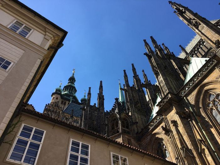 Low angle view of gothic church against blue sky