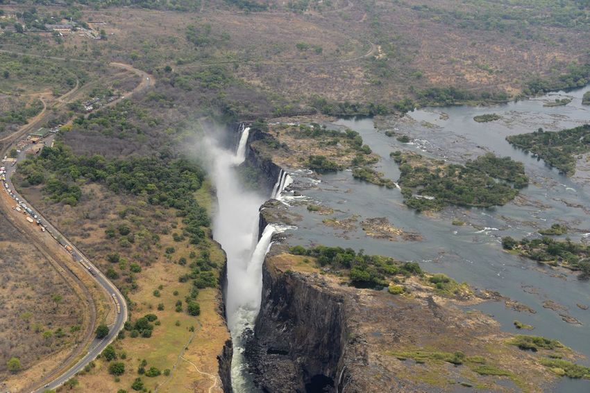 Arial Shot National Park Victoria Falls Africa Zimbabwe Zambesi River Zambia Zimbabwe Arial Arial Photography Arial View Arialview Beauty In Nature Border Day High Angle View Landscape Outdoors Power In Nature River Scenics Victoria Falls Victoria Falls In Zambia, Africa View From Helicopter Water Waterfall Zambesi