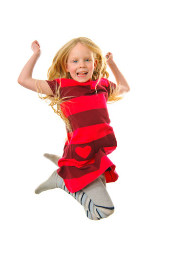 Little blond girl is jumping Childhood Child Girls White Background Looking At Camera Happiness Portrait Smiling Hair Emotion Cut Out Studio Shot Full Length Blond Hair Indoors  Cheerful One Person Positive Emotion Human Arm Arms Raised Hairstyle Innocence Cute Jumping Jumpshot