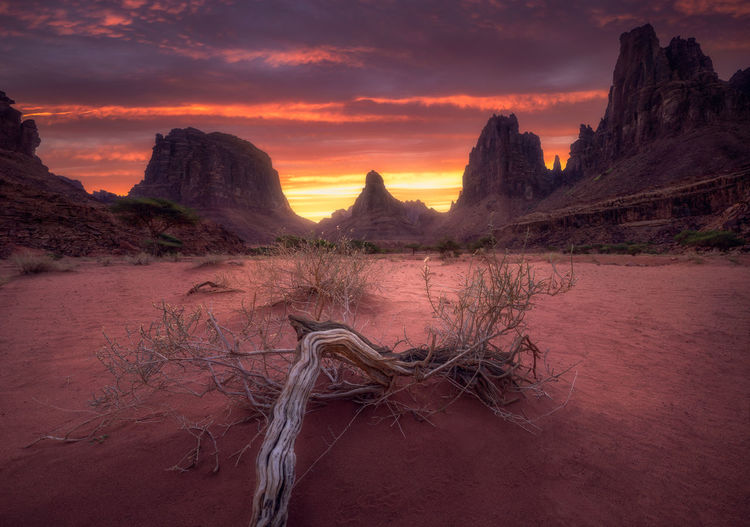 Red Sunrise Arid Climate Beauty In Nature Cloud - Sky Environment Eroded Formation Idyllic Land Landscape Mountain Nature No People Non-urban Scene Rock Rock - Object Rock Formation Scenics - Nature Sky Solid Sunset Tranquil Scene Tranquility Travel Destinations