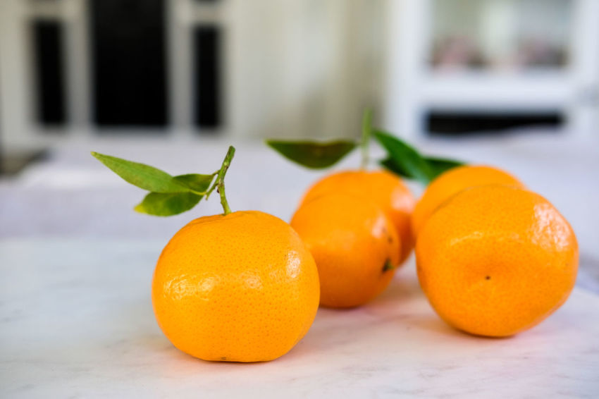 Mandarins Citrus Fruit Close-up Day Focus On Foreground Food Food And Drink Freshness Fruit Healthy Eating Indoors  Leaf Mandarin Mandarins No People Orange Orange Color