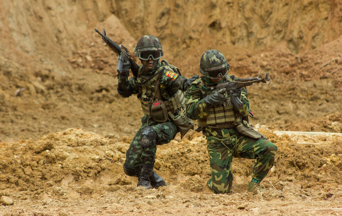 Unidentified A Soldier at Shan State in Myanmar EyeEmNewHere Adult Aggression  Armed Forces Army Soldier Conflict Day Fighting Full Length Government Gun Helmet Land Military Nature Outdoors People Protection Security Special Forces Two People Uniform Weapon