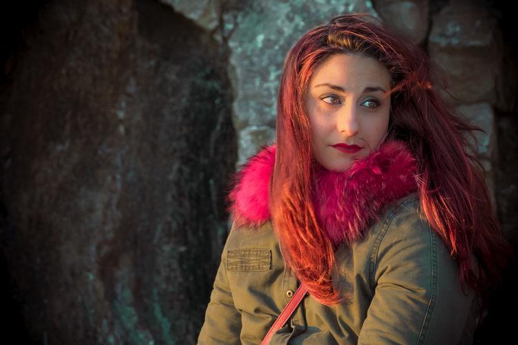 Beautiful Redhead Woman Against Rock Formation