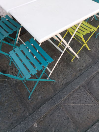 High angle view of empty chairs on table