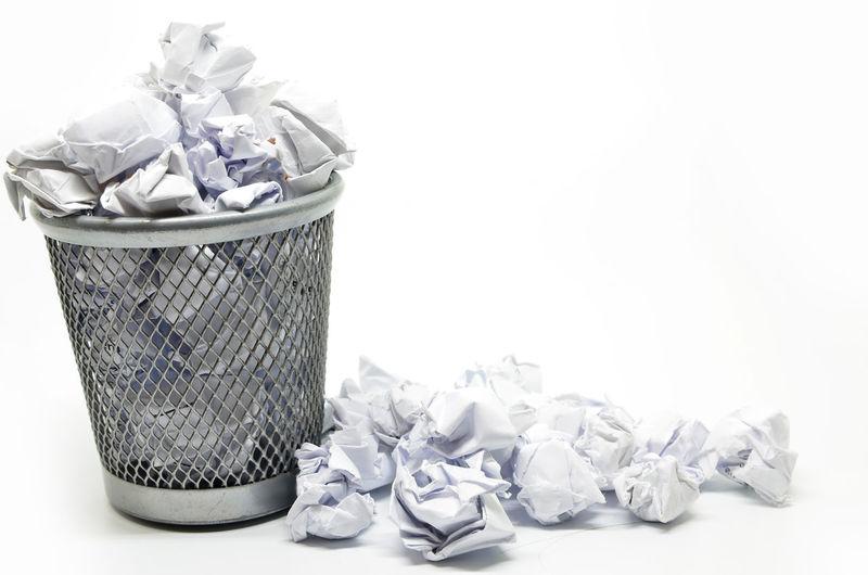 Garbage bin against white background