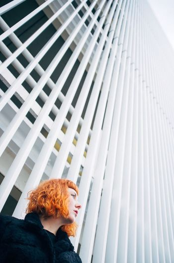 Low angle view of woman looking away
