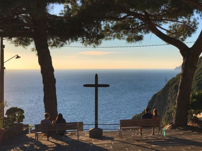 Just enjoying the ocean view Golden Hour Italy Cinque Terre Peaceful View Enjoying The Sun Sunset Edge Of The Cliff Water Sea Tree Religion Cross Spirituality Nature Tranquility Sky Beauty In Nature Horizon Over Water Tranquil Scene Outdoors Scenics - Nature