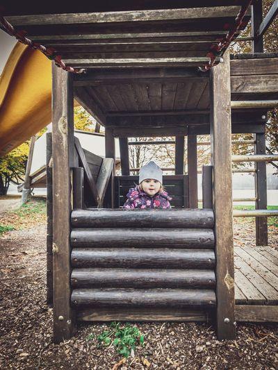 Portrait of girl sitting on slide