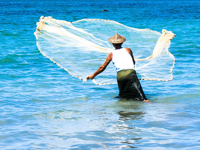 Adults Only Ankle Deep In Water Bay Of Bengal Day Fisherman Fishernet Full Length Hat Holding Leisure Activity Lifestyles Nature in Ngapali Beach, Myanmar Occupation Outdoors People Real People Rear View Sea Sommergefühle Standing Water Waterfront