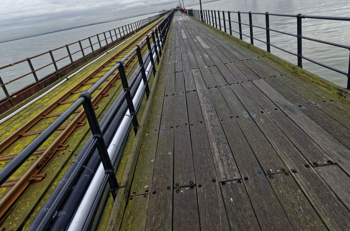 Southend Pier, The Longest Pier in the World, Southend-on-Sea, Essex, Britain. Britain Essex Pier Skies Southend On Sea Thames Weathered Wood Clouds Dramatic Dramitic Sky England Estuary Longest Moss Old Pleasure River Seaside Southend Town Uk Wooden World Worn