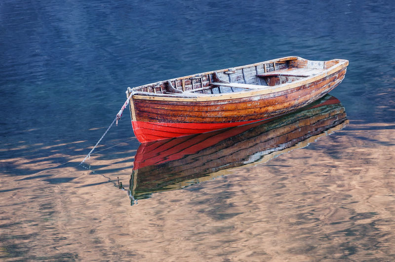 High angle view of abandoned boat moored on shore