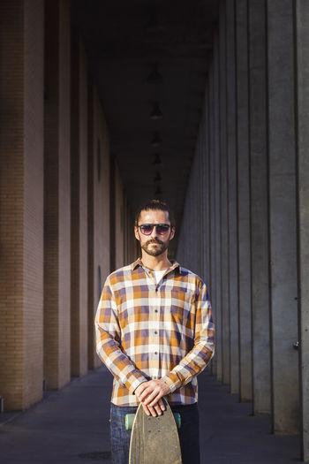 Portrait of man standing on corridor