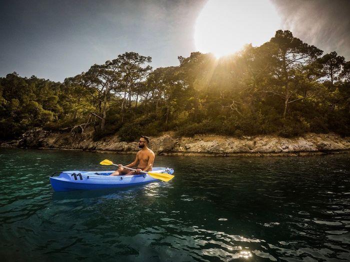 Paddling away Strand Meer Urlaub Hollidays Tour Allone  Break Bluelagoon Paddeling Kayaking Kayak Water Sunlight Nature One Person Sky Tree Nautical Vessel Men Outdoors Sun Lifestyles Real People The Great Outdoors - 2018 EyeEm Awards The Traveler - 2018 EyeEm Awards