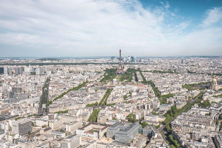 Aerial View Architecture Building Exterior Built Structure Capital Cities  City Cityscape Cloud - Sky Copy Space Crowded Day Development Eiffel Tower French Culture High Angle View International Landmark Montparnasse Outdoors Panoramic Rooftop Sky Tourism Travel Destinations Tree Wide