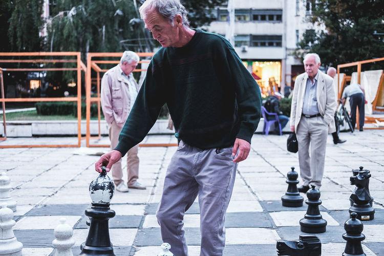 Full length of men standing on street in city