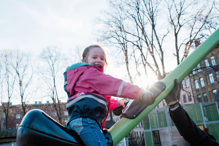 Low angle view of girl playing on playground