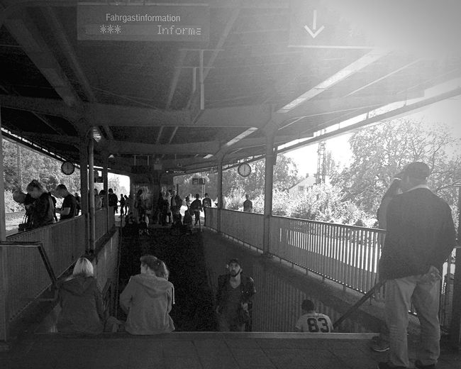 Train Station Bnw_friday_eyeemchallenge Blackandwhite People Waiting For A Train EyeEmSpy Into The Light spy the 83, the information desk, two girls sitting on the stairs, the man with the beard, the station clock (is this the right english word???)
