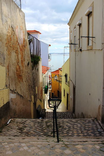 EyeEm City Photography Lissabon, Portugal Lisbon - Portugal Lisbon Alfama Alfama In Lisbon Architecture Built Structure Building Exterior Building Sky No People Residential District Cloud - Sky City Day Wall - Building Feature Wall Outdoors House Street Town Cobblestone The Way Forward
