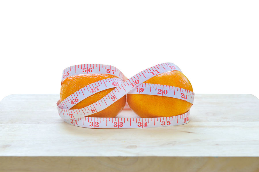orange with measure tape isolated on white background Citrus  Concepts Diet Exercising Cellulitis Close-up Closeup Color Communication Conscious Day Dumbbell Fitness Food Fresh Fruit Heart Shape Love No People Paper Still Life Studio Shot Sweet Food Text White Background