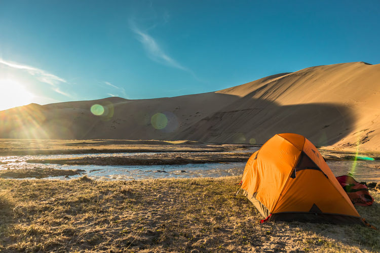 Mongolia Sky Scenics - Nature Land Sunlight Beauty In Nature Nature Tranquility Tranquil Scene Non-urban Scene Sand Remote Environment Landscape Day Sand Dune Mountain Tent Real People Cloud - Sky Blue Outdoors Climate Arid Climate The Traveler - 2019 EyeEm Awards
