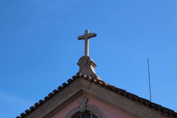 High section of church against clear blue sky