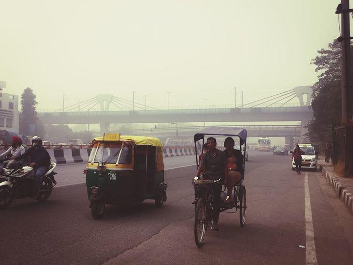 Indian Scene Auto Rikshaw Bike Fog Delhi Diary  Delhi Road Delhi Weather Mode Of Transport Men Sky EyeEmNewHere Eyeemphotography EyeEm Gallery Adapted To The City EyeEmNewHere EyeEmNewHere