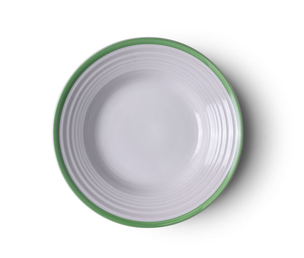 High angle view of empty plate against white background