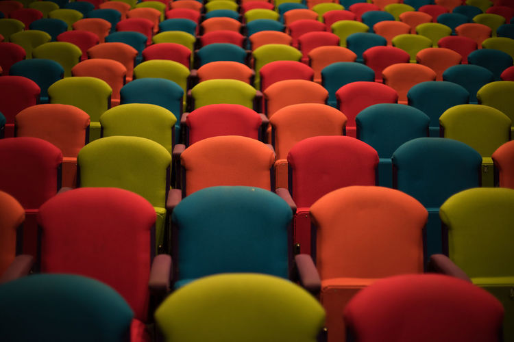 Full frame shot of multi colored empty seats