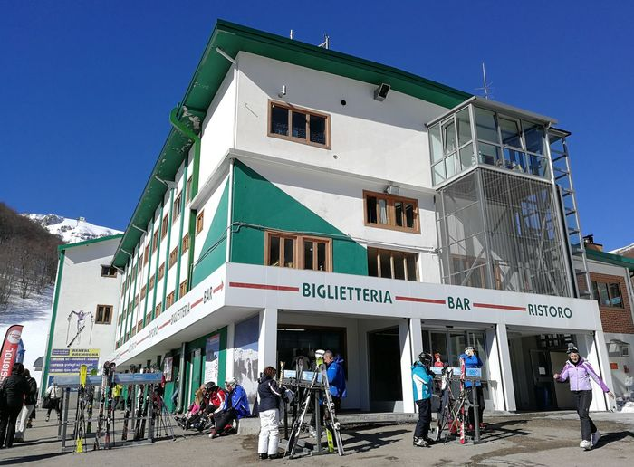 Architecture Building Exterior Built Structure Group Of People Real People City Sky Men Crowd Building Transportation Large Group Of People Nature Lifestyles Clear Sky Adult Women Day Street Outdoors Ticket Office Roccaraso Ski Runs Ski Lift Ski Area